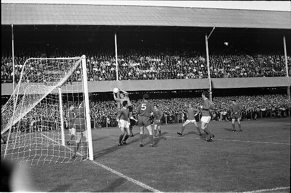 Waterford FC vs Manchester United at Lansdowne Road..1968..18.09.1968..09.18.1968..18th September 1968..Waterford FC as champions of the league of Ireland drew Manchester United, the European Champions,in the first round of this years competition.The Waterford team was as follows: Peter Thomas, Peter Bryan, Noel Griffin, Vinny Maguire, Jackie Morley, Jimmy McGeough, Al Casey, Alfie Hale, John O'Neill, Shamie Coad and Johnny Matthews. Manchester United won the tie 3 -1 with Denis Law being the man of the match..Alex Stepney,Tony Dunne,Francis Burns,Paddy Crerand,.Bill Foulkes,Nobby Stiles,George Best,Denis Law,.Bobby Charlton,David Sadler,Brian Kidd were the starting eleven for United...Image shows Peter Thomas taking command of the situation during a United corner.