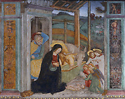 Nativity, detail from a fresco of the crucifixion and scenes from the life of Christ, 1513-15, by an unknown Renaissance Lombard artist of the Scotto school, on the partition wall of the Church of Santa Maria delle Grazie, a Franciscan church built 1480-82 and consecrated 1505, in Bellinzona, Ticino, Switzerland. Picture by Manuel Cohen