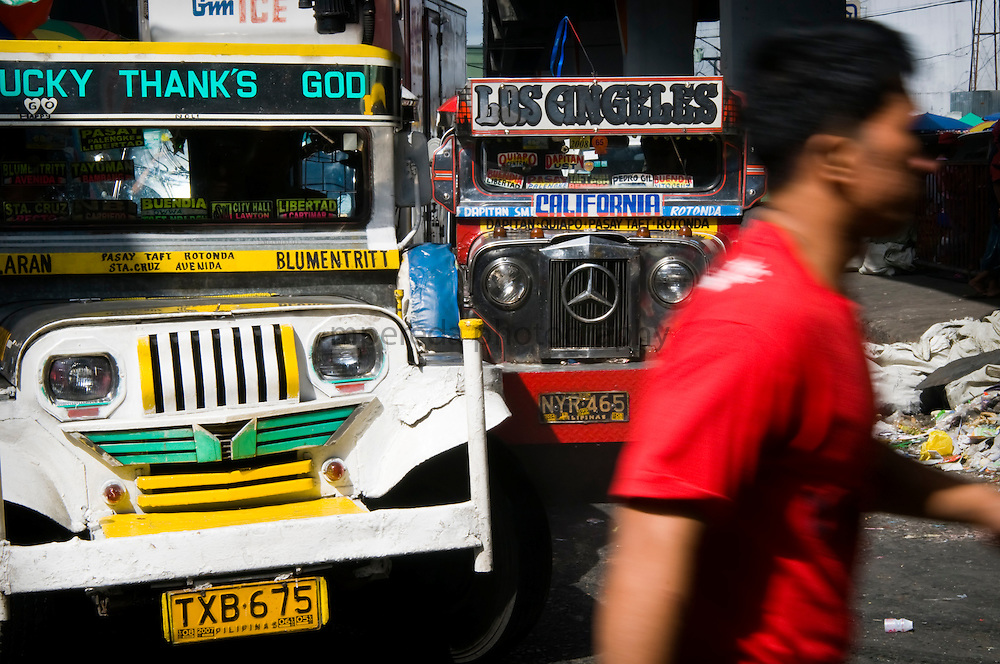 MANILA (Philippines). 2009. Jeepneys in Manila. Jeepneys were originally made from US military jeeps left over from the WWII. Nowadays are the most popular means of public transportation in the Philippines and also become a symbol of Philippine culture.