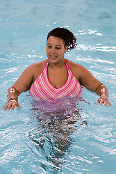 Pregnant woman taking part in an Aquanatal class,