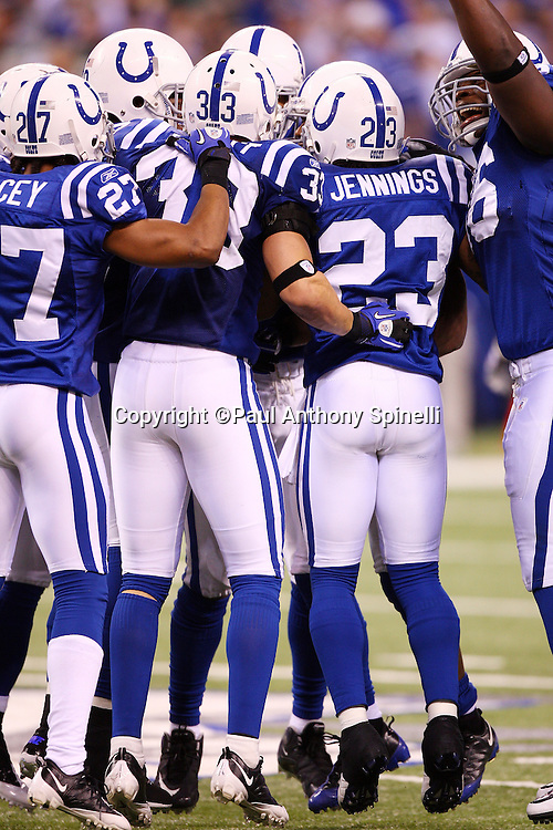 Indianapolis Colts defenders jump in unison after a game clinching interception by the Colts during the AFC Championship football game against the New York Jets, January 24, 2010 in Indianapolis, Indiana. The Colts won the game 30-17. ©Paul Anthony Spinelli