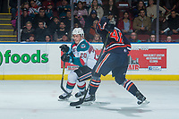KELOWNA, CANADA - DECEMBER 27: Conner Bruggen-Cate #20 of the Kelowna Rockets puts the puck past Brady Reagan #40 of the Kamloops Blazers during third period on December 27, 2017 at Prospera Place in Kelowna, British Columbia, Canada.  (Photo by Marissa Baecker/Shoot the Breeze)  *** Local Caption ***
