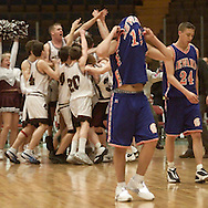 Times Herald-Record/TOM BUSHEY.S.S. Seward's Joe Hoyt, left, and Rob Gillespie (24) walk off the court as Harrisville players celebrate their 65-56 victory in a Class D state semifinal at the Glens Falls Civic Center yesterday afternoon..March 15, 2002..