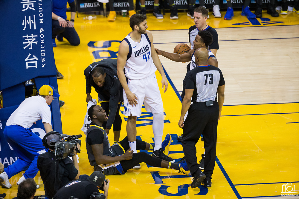 Golden State Warriors forward Draymond Green (23) yells at referee Tre Maddox (73) after being fouled at the rim by the Dallas Mavericks at Oracle Arena in Oakland, California, on February 8, 2018. (Stan Olszewski/Special to S.F. Examiner)