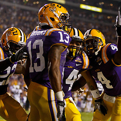 November 13, 2010; Baton Rouge, LA, USA; LSU Tigers cornerback Ron Brooks (13) celebrates with teammates following an interception return for a touchdown during the first half against the Louisiana Monroe Warhawks at Tiger Stadium. LSU defeated Louisiana-Monroe 51-0.  Mandatory Credit: Derick E. Hingle