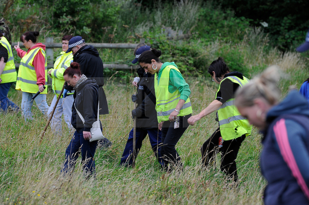 © Licensed to London News Pictures. 06/08/2012 . Police and volunteers searching Spring Parknear Croydon, South London for Missing 12 year old Tia Sharp, on August 6, 2012. 12 year old Tia Sharp has been missing from the Lindens on The Fieldway Estate in New Addington since Friday last week. Photo credit : Grant Falvey/LNP