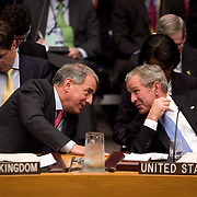 U.S. President George W. Bush (R) talks with Britain's Minister of State at the Foreign and Commonwealth Office Kim Howells during a UN Security Council meeting on Africa at the UN  Tuesday, September 25, 2007 in New York City...Photo by Khue Bui