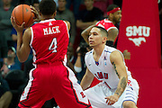DALLAS, TX - JANUARY 21: Nic Moore #11 of the SMU Mustangs defends against Myles Mack #4 of the Rutgers Scarlet Knights on January 21, 2014 at Moody Coliseum in Dallas, Texas.  (Photo by Cooper Neill/Getty Images) *** Local Caption *** Nic Moore; Myles Mack