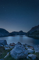 Stars over Sawtooth Lake in the night sky. Sawtooth Mountains Idaho