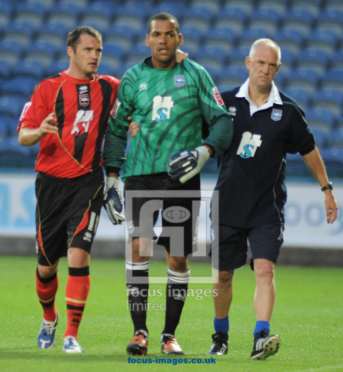 Huddersfield - Tuesday August 18th, 2009: Michael Kuipers of Brighton is led off the pitch after getting a red card during the Coca-Cola Football League One match at Huddersfield. (Pic by John Rushworth/Focus Images)..