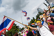 04 AUGUST 2013 - BANGKOK, THAILAND:      A man shouts anti-government slogans during a rally against former Prime Minister Thaksin Shinawatra and the current Prime Minister, Yingluck Shinawatra, his sister. About 2,000 people, members of the  People's Army against Thaksin Regime, a new anti-government group, protested in Lumpini Park in central Bangkok. The protest was peaceful but more militant protests are expected later in the week when the Parliament is expected to debate an amnesty bill which could allow Thaksin Shinawatra, the exiled former Prime Minister, to return to Thailand.   PHOTO BY JACK KURTZ