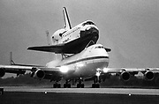 The Shuttle Discovery returns to Kennedy Space Center, Florida 8 October, 1988 atop a specially designed Boeing 747 transport jet. Bob Pearson/AFP
