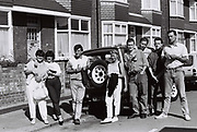 Group of friends gathering on August Bank holiday afternoon, Southall, UK, 1987.