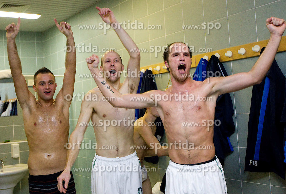 Players of Slovenia celebrate in a wardrobe after winning during the futsal match between National Teams of Slovenia and Latvia in Qualifications for European Championships, on February 25, 2011 in Arena Tri Lilije, Lasko, Slovenia. Slovenia defeated Latvia 4-3 and qualified for Euro 2012 in Croatia.  (Photo By Vid Ponikvar / Sportida.com)
