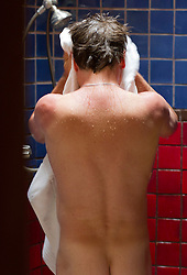 rear view of a man toweling off after a shower