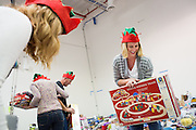 Dathan Holloway of Cisco Systems, Inc., Global Procurement Services department sorts donated toys at The Family Giving Tree in Milpitas, California, on December 18, 2014. (Stan Olszewski/SOSKIphoto)