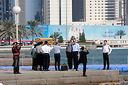 Chinese businessmen taking souvenir photos in front of the Western Corniche.