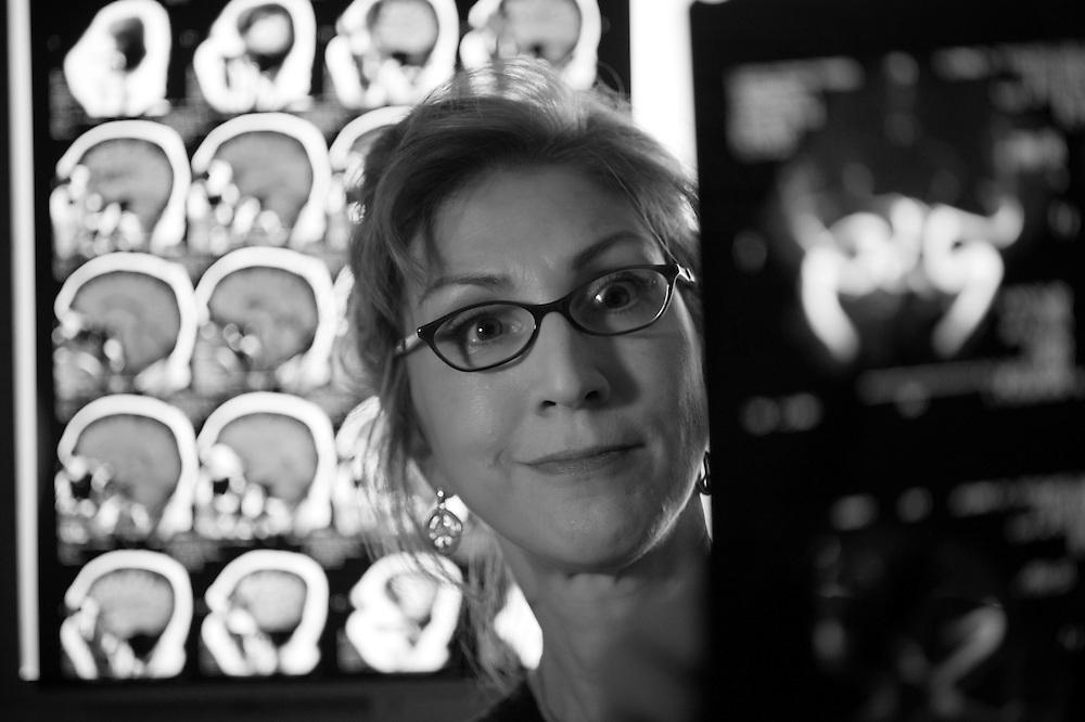 Woman studying MRI film