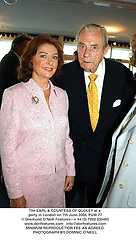 The EARL & COUNTESS OF DUDLEY at a party in London on 7th June 2004.PUW 77