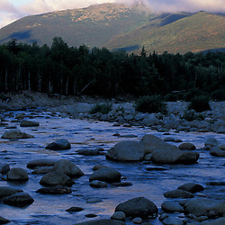 White Mountain National Forest.  View of Mt. Madison and the rocky Peabody River from NH Route 16. Northern Presidentials. Early morning. Gorham, NH