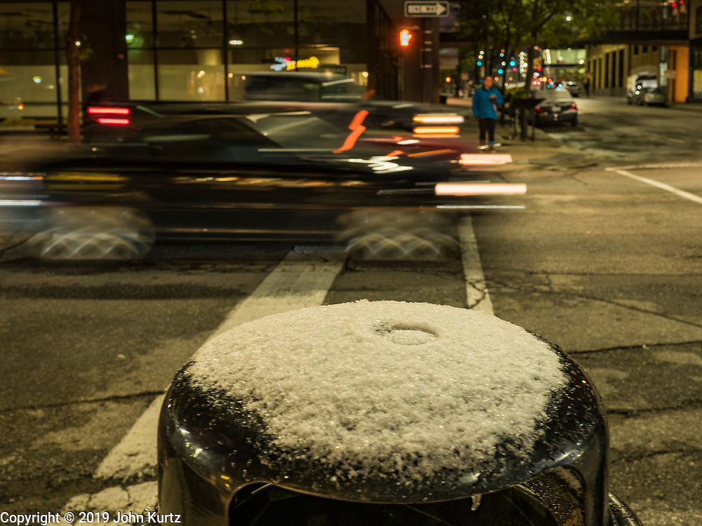 29 OCTOBER 2019 - DES MOINES, IOWA: A dusting of snow on top of a trash can in downtown Des Moines early in the morning after an unseasonably early snow. An unseasonably early dusting of snow, less than 1 inch, blanketed the Des Moines area Tuesday morning. The snow did not accumulate on roads or sidewalks. Des Moines normally gets its first accumulation of snow in mid-November. More snow is expected later this week.               PHOTO BY JACK KURTZ