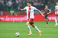 Poland's Robert Lewandowski controls the ball during the EURO 2016 qualifying match between Poland and Germany on October 11, 2014 at the National stadium in Warsaw, Poland<br /> <br /> Picture also available in RAW (NEF) or TIFF format on special request.<br /> <br /> For editorial use only. Any commercial or promotional use requires permission.<br /> <br /> Mandatory credit:<br /> Photo by © Adam Nurkiewicz / Mediasport