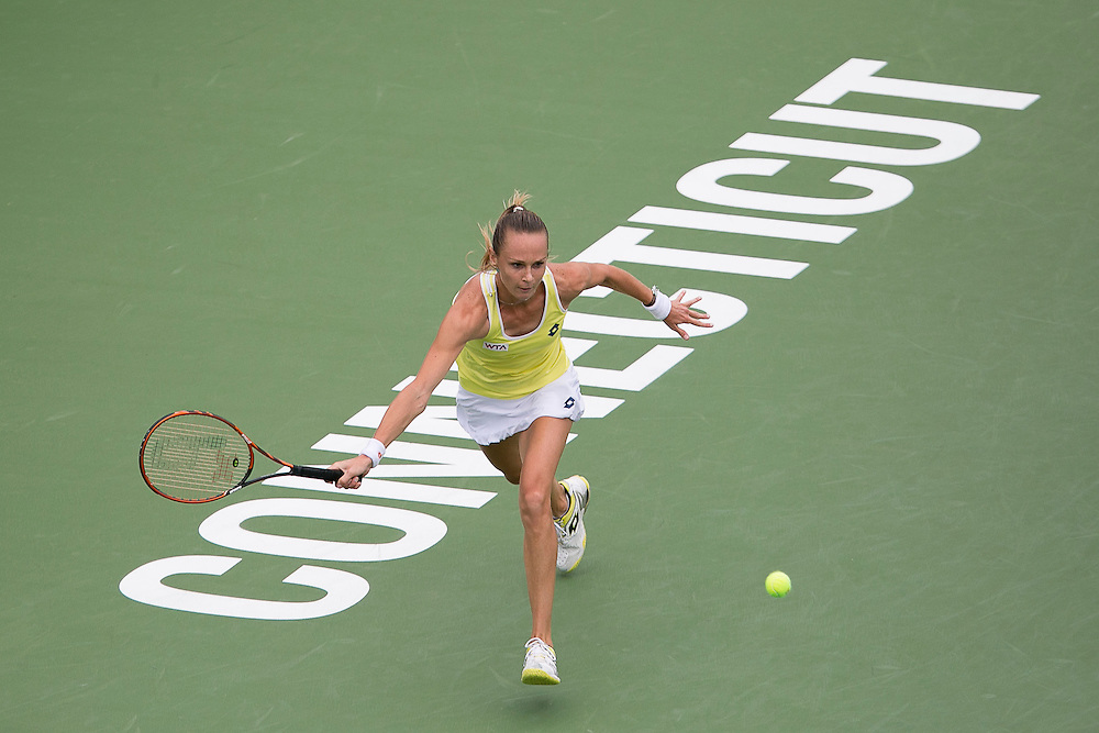 August 22, 2014, New Haven, CT:<br /> Magdalena Rybarikova hits a forehand during the semi-final match against Camila Giorgi on day eight of the 2014 Connecticut Open at the Yale University Tennis Center in New Haven, Connecticut Friday, August 22, 2014.<br /> (Photo by Billie Weiss/Connecticut Open)