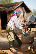 Young country girl grinding rice (Myanmar)