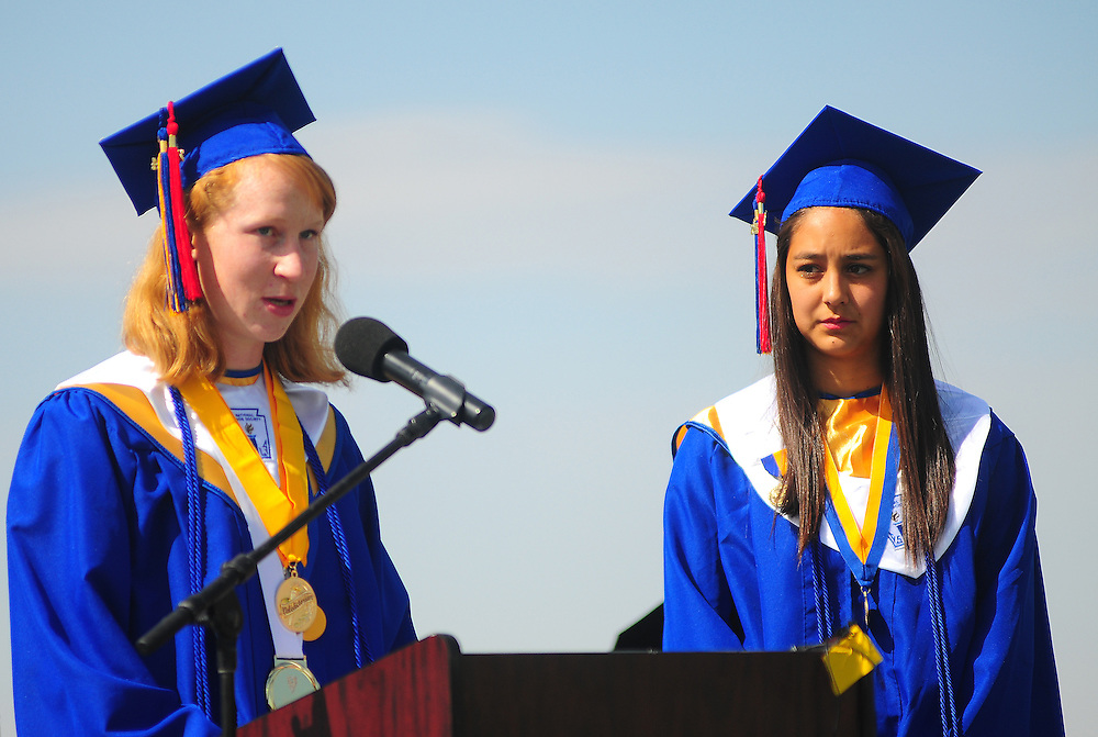apl052214n/ASECTION/pierre-louis/JOURNAL/052214 <br /> Santa Fe High School Valedictorian Greta Miller,, left  addresses  graduating classmates Ivan Head Stadium during the ceremony. At right is fellow valedictorian Eliana Otero-Bell. Photographed on Thursday May 22, 2014.  /Adolphe Pierre-Louis/Journal