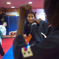 Tiana Tom practices kicks with Mukai Dube, right during Dylan Vargas's karate class in Gallup Monday.