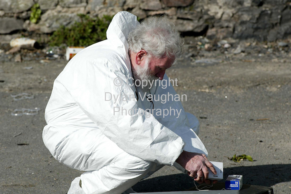 13/3/2002 .Dr John Harbison the State Pathologist pictured at the scene where Francis McDonagh's body was found in Carrick-On-Suir Co Tipperary yesterday..Picture Dylan Vaughan