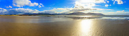 A nice panoramic shot I got from Tramore beach near Rossbegs, County Donegal in October 2013 on my weekend trip to Donegal. The low tide gave a nice thin film of water on the golden sands to give some lovely reflections of the Sun, clouds and Slievetooey off in the distance.<br /> <br /> Image composed of 5 photos at 18mm in landscape orientation. You can zoom in and take a closer look to see what this could look like on your wall here http://adambrooks.photoshelter.com/#!/p/I0000KumIzbBJcCE<br /> <br /> Available in sizes ranging from 8&quot;x28&quot; - 20&quot;x70&quot; (20cmx71cm - 51cmx178cm).