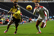 Sanchez Watt of Colchester United looks to get past Daniel Powell of MK Dons during the Sky Bet League 1 match between Milton Keynes Dons and Colchester United at stadium:mk, Milton Keynes<br /> Picture by Richard Blaxall/Focus Images Ltd +44 7853 364624<br /> 29/11/2014
