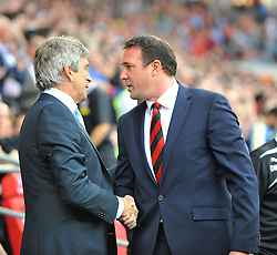 Manchester City Manager, Manuel Pellegrini shakes Cardiff City Manager, Malky Mackay hand before the game.  - Photo mandatory by-line: Alex James/JMP - Tel: Mobile: 07966 386802 25/08/2013 - SPORT - FOOTBALL - Cardiff City Stadium - Cardiff -  Cardiff City V Manchester City - Barclays Premier League