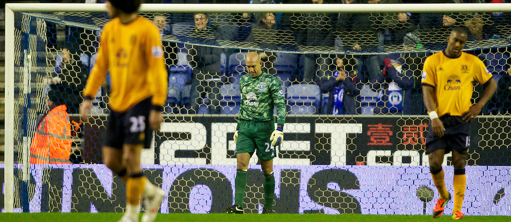 WIGAN, ENGLAND - Saturday, February 4, 2012: Everton's goalkeeper Tim Howard looks dejected after making a mistake to give Wigan Athletic their first goal during the Premiership match at the JJB Stadium. (Pic by Vegard Grott/Propaganda)