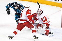 November 30, 2010; San Jose, CA, USA; Detroit Red Wings goalie Jimmy Howard (35) saves a shot from San Jose Sharks right wing Ryane Clowe (29) during the first period at HP Pavilion. Mandatory Credit: Jason O. Watson / US PRESSWIRE
