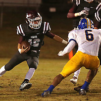 Lauren Wood | Buy at photos.djournal.com<br /> Kossuth's Austin Higgs runs the ball past Booneville's Mason Foster during Friday night's game at Kossuth.