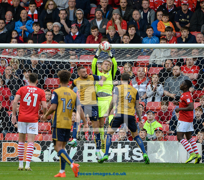Adam Davies of Barnsley takes a dangerous cross under pressure from Aaron Wilbraham of Bristol City during the Sky Bet Championship match at Oakwell, Barnsley<br /> Picture by Richard Land/Focus Images Ltd +44 7713 507003<br /> 29/10/2016