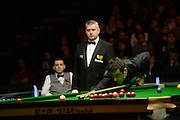 19.02.2016. Cardiff Arena, Cardiff, Wales. Bet Victor Welsh Open Snooker. Mark Selby versus Ronnie O'Sullivan. Ronnie O'Sullivan pots the red left handed.