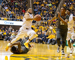 West Virginia Mountaineers guard Gary Browne (14) drives down the lane against the Texas Longhorns during the second half at the WVU Coliseum.