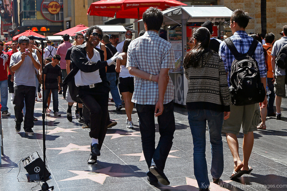 USA, California, Los Angeles. Hollywood Walk of Fame performer and tourists on Hollywood Boulevard.