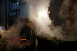 An ethnic Uighur man sits behind steaming pots of food on sale in Urumqi city, Xinjiang Uighur Autonomous Province, China, 18 November 2017. Uighurs, a Muslim ethnic minority group in China, make up about 40 per cent of the 21.8 million people in Xinjiang, a vast, ethnically divided region that borders Pakistan, Afghanistan, Kazakhstan, Kyrgyzstan and Mongolia. Other ethnic minorities living in here include the Han Chinese, Kyrgyz, Mongolian and Tajiks people. Xinjiang has long been subjected to separatists unrests and violent terrorist attacks blamed by authorities on Islamist extremism while human rights groups say Chinese repression on religious rights, culture and freedom of movement caused undue tensions. Life however goes on under the watchful eye of the government for the ethnic Uighurs living in the city of Urumqi and surrounding areas and the region is still considered an attractive tourist spot. A recent report by state media Xinhua news agency claims Xinjiang received more than 100 million tourists in 2017, 'the highest figure in its history'.