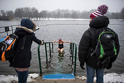 © Licensed to London News Pictures. 03/03/2018. London, UK. A members of the Serpentine Swimming Club leaves the water after braving freezing overnight temperatures to take part in an early morning swimming race at sunrise in the Serpentine in Hyde Park, London. Large parts of the UK are recovering from a week of sub zero temperatures and heavy snowfall, following two severe cold fronts. Photo credit: Ben Cawthra/LNP