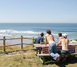 Boys hanging out on a picnic table over looking the coast of Oregon