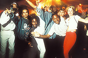 Clubbers pose for the camera, rave at Bagleys, London, U.K, 1996.