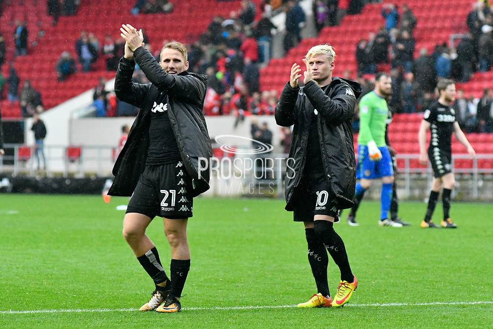 Samuel Saiz (21) of Leeds United and Ezgjan Alioski (10) of Leeds United applaud the Leeds fans at full time after a 3-0 win during the EFL Sky Bet Championship match between Bristol City and Leeds United at Ashton Gate, Bristol, England on 21 October 2017. Photo by Graham Hunt.