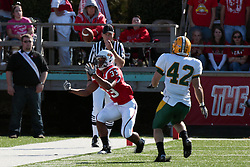 16 October 2010:  Derrick Lang zeros in on Cameron Hunt who is bobbling the reception of a kick during a game where the North Dakota State Bison lost to the Illinois State Redbirds 34-24, meeting at Hancock Stadium on the campus of Illinois State University in Normal Illinois.