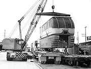 A crane moved into position to unload the second World's Fair Monorail train at Northern Pacific Railway's Terry Avenue freight station in 1962. (The Seattle Times)