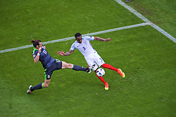 LENS, FRANCE - Thursday, June 16, 2016: Wales' Gareth Bale in action against England's Danny Rose during the UEFA Euro 2016 Championship Group B match at the Stade Bollaert-Delelis. (Pic by Paul Greenwood/Propaganda)