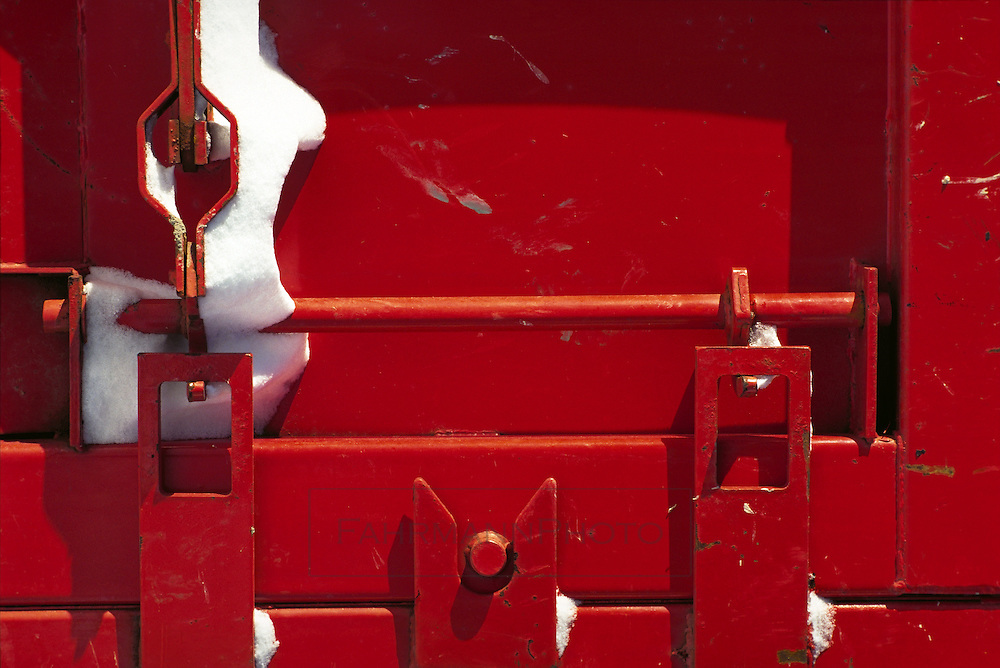 Bright red dumpster with snow
